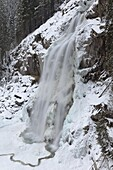 The Krimml waterfalls in the National Park Hohe Tauern during winter in ice and snow  The lower Fall The Krimml waterfalls are one of the biggest tourist attractions in Austria and the Alps  They are visited by around 400 000 tourists every year  The wate