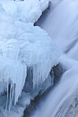 The Krimml waterfalls in the National Park Hohe Tauern during winter in ice and snow  Detail of the middle Fall  The Krimml waterfalls are one of the biggest tourist attractions in Austria and the Alps  They are visited by around 400 000 tourists every ye