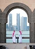 Museum of Islamic Art in Doha with skyline of city to rear, Qatar, architect IM Pei