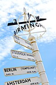 Finger post at Birmingham Airport, highlighting distance to international destinations  England, UK