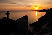 sunset at the rocky coast at the small holiday resort of Toroni, Sithonia, Greece