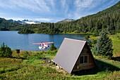 USA, Alaska, Prince William Sound, Shrode Lake, float plane parked by US Forest Service cabin