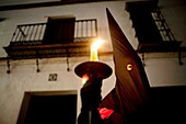 A penitent participates in a Holy Week procession in the town of Prado del Rey in southern Spain´s Cadiz Sierra region in Andalucia. Easter processions in Andalucia during Holy Week are a public display of Catholic imagery which tells the story of Jesus C