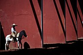 A Mexican charro ride his horse at the National Charro Championship in Pachuca, Hidalgo State, Mexico. Escaramuzas are similar to US rodeos, where female competitors called ´Amazonas´ wear long skirts, and ride side saddle Male rodeo competitors are ´Char