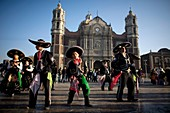 Pilgrims dance outside the Our Lady of Guadalupe Basilica in Mexico City, December 8, 2010  Hundreds of thousands of Mexican pilgrims converged on the Basilica, bringing images to be blessed, as processions filled the streets for the feast day of Our Lady