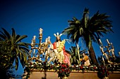A sculpture of Jesus riding a donkey is carried during a religious procession during the palm sunday in the town of Prado del Rey in southern Spain´s Cadiz Sierra region in Andalucia, March 28, 2010  Easter processions in Andalucia during Holy Week are a