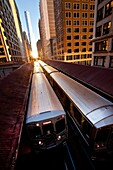 Sunrise illuminates a train in the Chicago rapid transit system known as the´L´ in Chicago, IL, USA