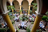 Photograph from above of the interiors of the open air restaurant El Patio with people eating and drinking, SAN IGNACIO 54, PLAZA DE LA CATEDRAL, HABANA VIEJA, HAVANA, CUBA