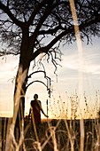 Maasai Warrior at Sunrise - Masai Mara National Reserve, Kenya