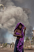 Especially the children suffer from the constant ash fall, Tavurvur Volcano, Rabaul, East New Britain, Papua New Guinea, Melanesia, Pacific
