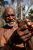 Eliab Wutab holding a young megapode bird. He releases it on Matupit island and hopes that it will find more food on the slopes of the volcano. Tavurvur Volcano, Rabaul, East New Britain, Papua New Guinea, Melanesia, Pacific