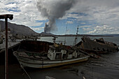The ship yard. Rabaul harbour was an important place for container ships to unload and a safe harbour for visiting yachts. Nowadays, the harbour is less deep due to the constant ash fall and the ships are buried under the weight of the ash. Tavurvur Volca