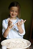 Girl with sticky hands, Klein Thurow, Roggendorf, Mecklenburg-Western Pomerania, Germany