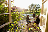 People sitting in a garden while preparing supper, Klein Thurow, Roggendorf, Mecklenburg-Western Pomerania, Germany