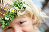 Little girl with flower garland on her head