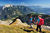 Young woman and young man hiking, Guffert in background, Unnutz, Brandenberg Alps, Tyrol, Austria