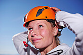 Young woman with climbing helmet, Kampenwand, Chiemgau Alps, Chiemgau, Upper Bavaria, Bavaria, Germany