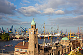View over St. Pauli Landungsbrücken onto the cranes at the harbour, Hamburg, Gemany, Europe