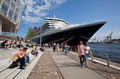People in front of cruise ship Queen Mary 2 at harbour, Hamburg Cruise Center Hafen City, Hamburg, Germany, Europe