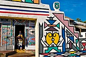 Africa, South Africa, Mpumalanga Province, KwaNdebele, Ndebele tribe, Mabhoko village, the artist Francina Mbonani coming out of her house