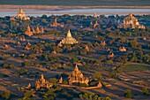 Myanmar (Burma), Mandalay State, Bagan (Pagan), view from an hot-air balloon, Shwesandaw Pagoda (Paya Shwesandaw, end of 11th), Thatbyinnyu Temple (Pahto Thatbyinnyu, middle of 12th) and Gawdawpalin Temple (Pahto Gawdawpalin, end 12th-beginning 13th)