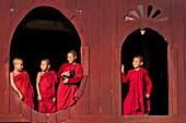 Myanmar (Burma), Shan State, Shwe Yan Pye, Shwe Yan Pye monastery, bonzes like to look at the oval windows of the temple