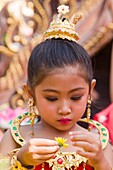 Thailand,Chiang Mai,Portrait of Girl in Traditional Thai Costume at the Chiang Mai Flower Festival