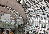 Gate at Bangkok Airport with airplanes in background. Curved glass roof and walls. Architecture., Bangkok, Thailand/Airport Terminal Gate