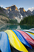 Colorful canoes on dock of Moraine Lake, in Banff National Park. The Canadian Rockies landscape, Mountain peaks. Flat calm water. Kayaks., Moraine Lake, Banff National Park Alberta Canada