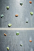 A Climbing wall with a series of hand and foot holds, in a playground or sports centre in Hockinson, Washington, USA, Climbing wall on playground