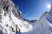 Group of people backcountry skiing, preparing for the downhill, Kaiserexpress backcountry ski tour, Rote Rinn-Scharte, Wilder Kaiser, Kaiser mountain range, Tyrol, Austria