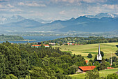Chiemgau Alps and view of Lake Chiemsee as seen from the Ratzinger Hoehe, Chiemgau, Bavaria, Germany