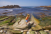 Child on the waterfront, Point Lobos State Reserve, Pacific coast, Pacific Ocean, Highway 1, California, USA, America