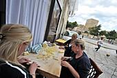Local women making Orecchiette pasta in the old town of Bari, Apulia, Italy