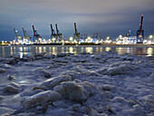 Frozen Elbe river with Waltershof container terminal in the evening, Hanseatic City of Hamburg, Germany, Europe