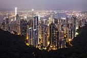 View from Victoria Peak onto the high rise buildings of Hong Kong Islandand Kowloon at night, Hongkong, China, Asia