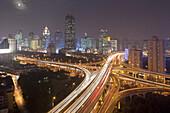 Crossroads of urban freeway Chongqing Zhong Lu and Yan'an Dong Lu at night, Shanghai, China, Asia