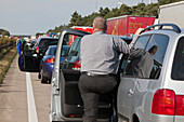 Vehicles at a standstill, people waiting in a traffic jam on the German Autobahn, Germany
