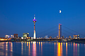 View over the Rhine river to Rhine tower and media harbour at night, Duesseldorf, North Rhine-Westphalia, Germany, Europe