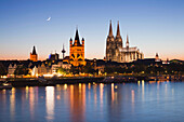 View over the Rhine river onto the old town with town hall, church Gross St Martin and cathedral in the afterglow, Cologne, North Rhine-Westphalia, Germany, Europe