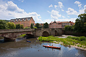Kayaks on the Werra river, view of the Welfenschloss castle, Hannoversch Muenden, Weser Hills, North Lower Saxony, Germany, Europe