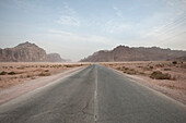 Empty road after sandstorm at Wadi Rum, Jordan, Middle East, Asia