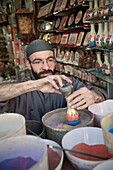 Sand artist at work for travel souvenir, capital Amman, Jordan, Middle East, Asia