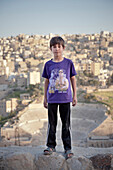 Jordanian boy posing in front of Roman Theatre, capital Amman, Jordan, Middle East, Asia