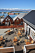View of cafe and houses at the harbour of Husavik, North Iceland, Europe