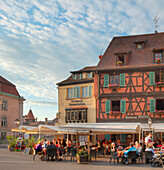 People in restaurants at the old town, Colmar, Alsace, France, Europe