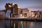 Spain, Basque Country Region, Vizcaya Province, Bilbao, The Guggenheim Museum, designed by Frank Gehry, dusk
