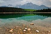 Patricia Lake at dawn with reflections of Pyramid Mountain, Jasper National Park, Alberta, Canada