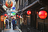 city , five , horizontal , Japan , Japanese , kanji , Kyoto , lantern , man , paper , Pontocho , red , walking , woman , World locations , S93-1573643 , AGEFOTOSTOCK