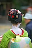 A Geisha taking part in the Setsubun Rituals at Yasaka Shine